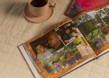 photo album and a tea cup
