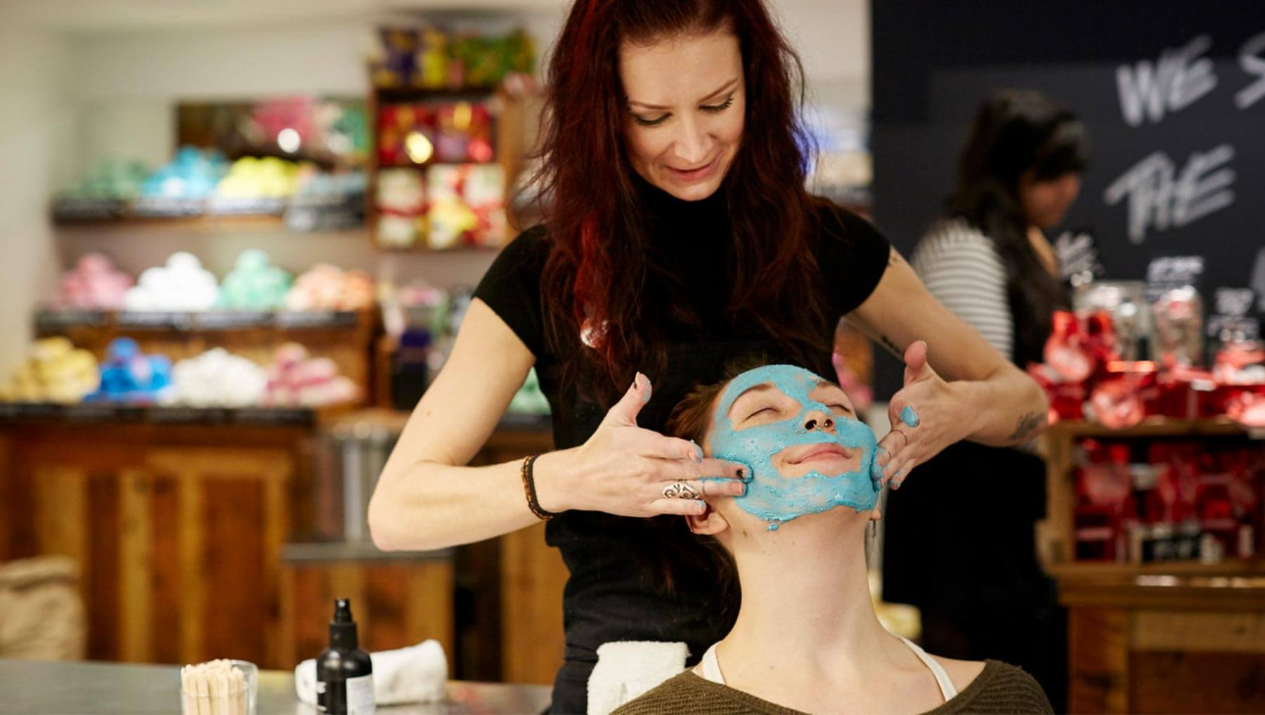 Staff member doing a face demo in-store