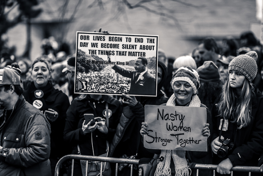 Women from a previous Women's March holding signs