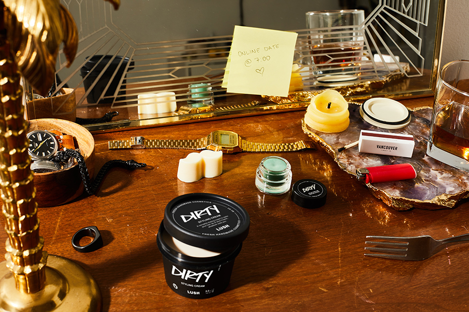 A dresser countertop with personal items and Dirty products in use.