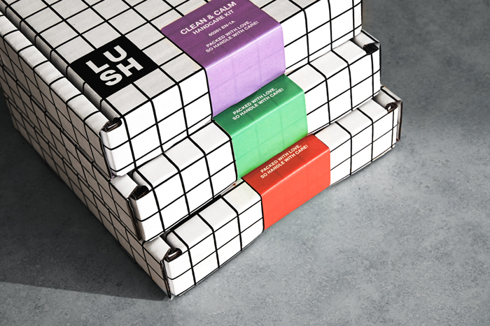 Our three new handcare kits stacked together with a gray background